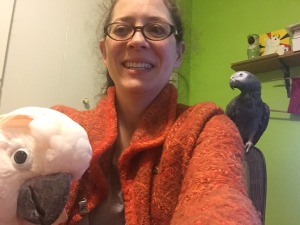 Jenny with her Cockatoo and African Grey